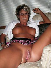 Older MILF is touching herself