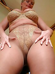 Astonishing older mistress showing her sexy curves