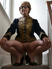 Amazing older mistress playing with her jugs
