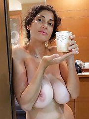 Mature mistress is posing seminaked